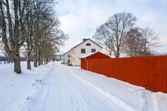 Winter scenery with red wooden house. In Sweden Stock Photography