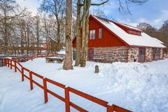 Winter scenery with red wooden house. In Sweden Royalty Free Stock Photos