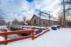 Winter scenery with river mill. In Sweden Stock Photography