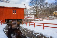 Winter scenery with river mill. In Sweden Royalty Free Stock Images