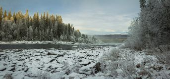 Winter landscape, frozen river near Tannforsen waterfall stock photo