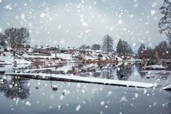 Winter scenery with snowfall at the lake. In Olofstrom, Sweden Stock Photography