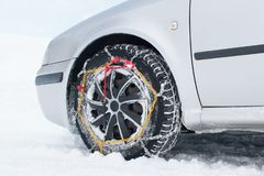 Car with tyre chains in winter stock photo
