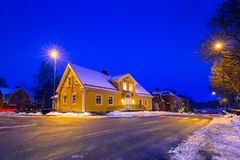 Winter scenery with wooden house at night. Winter scenery with yellow wooden house at night in Sweden Royalty Free Stock Image