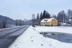 Winter scenery with yellow wooden house. In Sweden Stock Photo