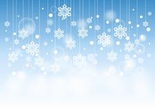 Winter-schöner Hintergrund mit den Schnee-Flocken, die Muster hängen Stockbild