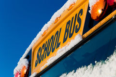 Winter School Bus. The front of a school bus after a fresh winter snowfall Royalty Free Stock Image
