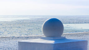 Winter on sea: sculpture and white seacoast Royalty Free Stock Photo
