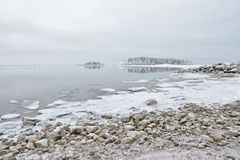 Winter by the sea. By the sea it is still open water, despite several degrees below zero Royalty Free Stock Photo