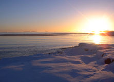 Winter sea sunset. The frozen sea on a background of a sunset Stock Photography