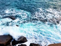 The winter sea wave beat against the rocks stock photo