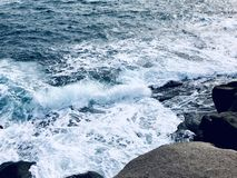 The winter sea wave beat against the rocks stock photos