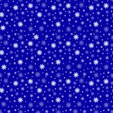 Winter seamless background with flat white snowflakes on a blue Royalty Free Stock Image