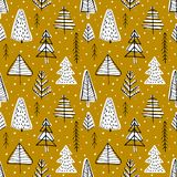 Winter seamless background. With pine trees in the forest on gold background Stock Photos