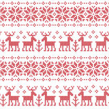 Winter seamless background with reindeer. Stock Photography