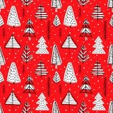 Winter seamless background. With pine trees in the forest on red background Royalty Free Stock Photos