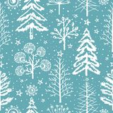 Winter seamless Christmas pattern for design packaging paper, postcard, textiles. NThe pattern with the image of fir-trees, trees, bushes covered with snow Royalty Free Stock Photography