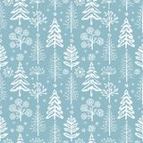 Winter seamless Christmas pattern for design packaging paper, postcard, textiles. NThe pattern with the image of fir-trees, trees, bushes covered with snow Royalty Free Stock Image
