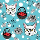 Winter seamless patten with red berries on the snow and smart cats. Royalty Free Stock Photography