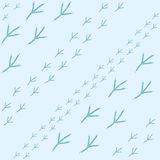 Winter seamless pattern with bird footprints on a bright-blue snowy background. Seamless Pattern with bird footprints on a bright-blue snowy background. Endless Royalty Free Stock Images