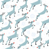Winter seamless pattern with cute jumping deers on white backgro Royalty Free Stock Photo