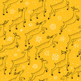 Winter seamless pattern with cute jumping deers on yellow backgr Royalty Free Stock Photography