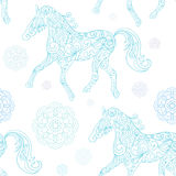 Winter seamless pattern with decorative horses Stock Photo