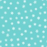 Winter seamless pattern. Drawn by hand. White snowflakes on blue background. vector illustration