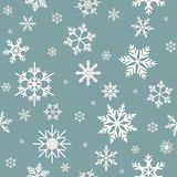 Winter seamless pattern with flat white snowflakes on powder blue background. Stock Photo
