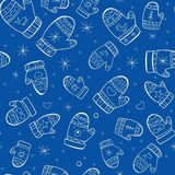 Winter seamless pattern with mittens on blue backg vector illustration