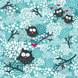 Winter seamless pattern with owls and snow. Stock Images