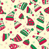 Winter seamless pattern with red-green hats Royalty Free Stock Image