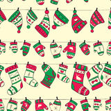 Winter seamless pattern with red green socks mitte. Ns and hats on yellow background Royalty Free Stock Photos