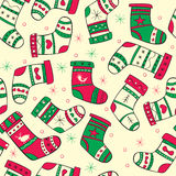 Winter seamless pattern with red-green socks. On the yellow background Stock Images