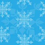 Winter seamless pattern with snowflake on blue background Royalty Free Stock Image