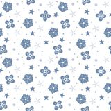 Winter seamless pattern with snowflakes, stars and flowers isola Royalty Free Stock Images