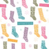Winter seamless pattern with socks Stock Photos