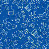Winter seamless pattern with socks on blue backgro Royalty Free Stock Photos