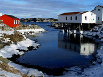 Winter Seascape. Winter Time in Rural Newfoundland with fishing stages Royalty Free Stock Photos