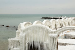 Winter seascape, frozen arch fence with huge icicles. After winter storm on the sea shore in St St Constantin and Helena, Bulgaria Royalty Free Stock Photography