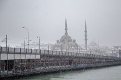 Winter seascape view of Popular New Mosgue and Galata Bridge Stock Image