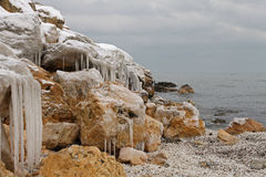 Winter seaside frozen landscape. Winter seaside frozen pier landscape Stock Image