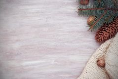 Winter Season Cristmas Frame with fir branches, Pinecones and knitted sweater on the Wooden background. Winter Season Cristmas Frame with fir branches Stock Images
