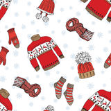 Winter season doodle clothes seamless pattern. Hand drawn sketch elements warm raindeer sweater socks, gloves and hats. vector bac Royalty Free Stock Image