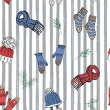 Winter season doodle clothes seamless pattern. Hand drawn sketch elements warm socks, gloves and hats. striped vector background i Royalty Free Stock Image