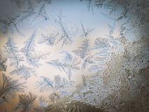Winter Season Fantasy World Theme Concept: Macro Image Of Colorful Light Frosty Window Glass Natural Ice Patterns.  stock photo