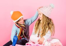 Winter season fashion accessories and clothes. Kids knitted winter hats. Children playful mood christmas holidays pink. Background. Winter accessories for kids stock images