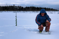 Winter season old man fishing on lake Royalty Free Stock Photo