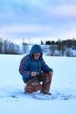 Winter season old man fishing on lake Stock Images