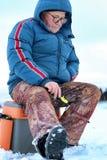 Winter season old man fishing on lake Royalty Free Stock Photos